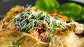 Square crepes with savory chicken and mushroom filling with parmesan