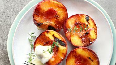 Gegrilde perziken stock