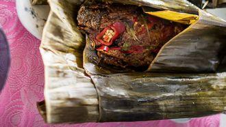 Makreel met pompoen in bananenblad